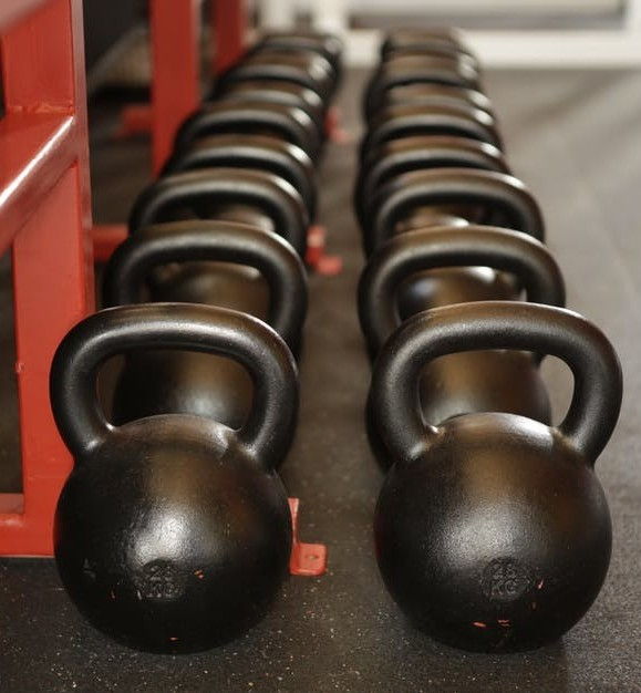 Row of kettle bells for core exercises for back pain