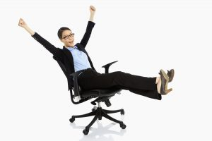 Woman celebrating, she found the best office chair for back bain