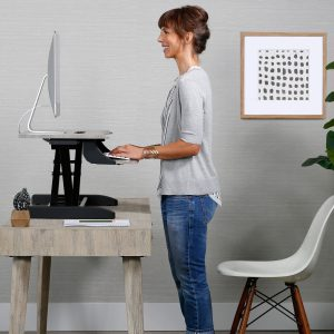 Woman standing at Best Sit-Stand Workstation