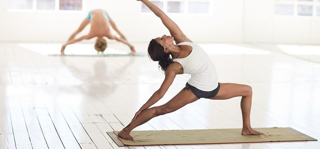 Woman performing simple yoga for beginners pose