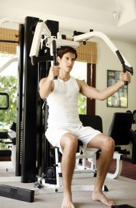 Man working out on best home gym system