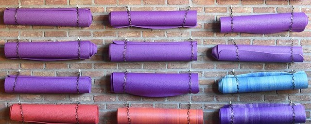 Yoga mats hanging on a wall, demonstrating Best Yoga Mats For 2018