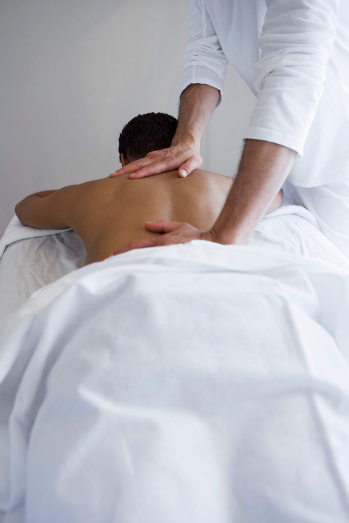 Man receiving massage for sciatica relief